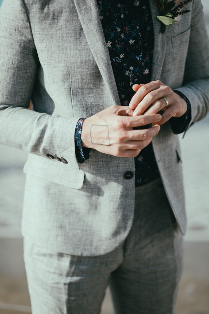 Custom suit and handmade wedding band